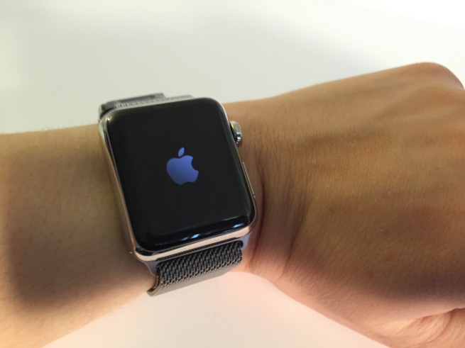 38 mm Milanese Apple Watch powering on