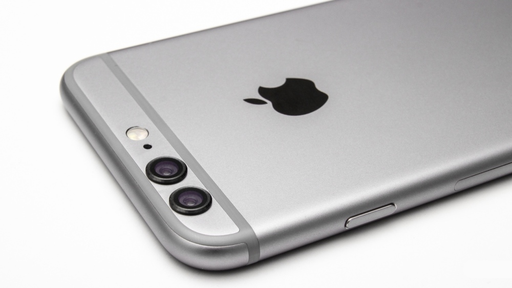 A mockup image showing the back of an iPhone 6 with a dual-camera