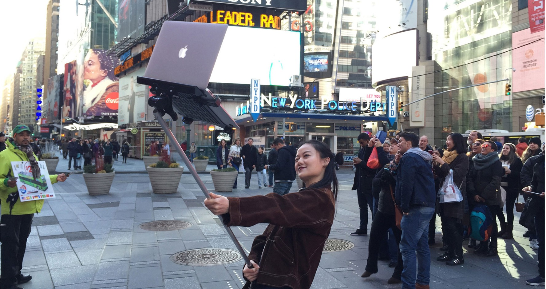Girl using MacBook Selfie Stick in Times Square