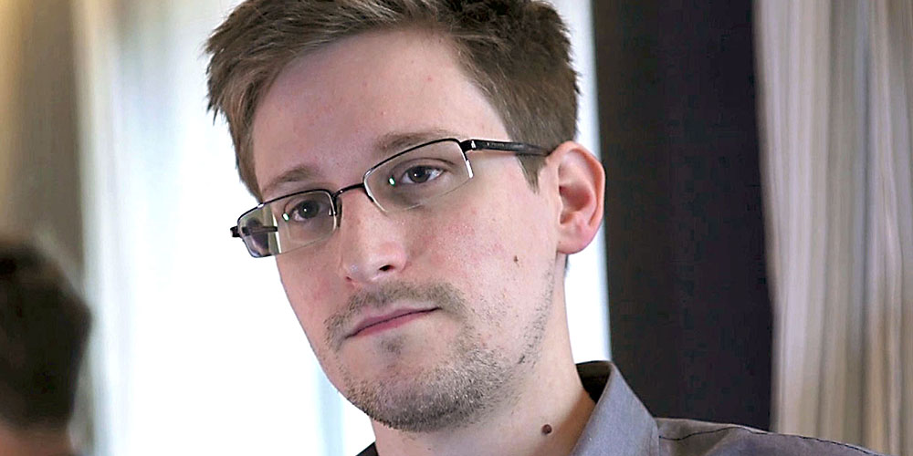 Former U.S. spy agency contractor Edward Snowden is interviewed by The Guardian in his hotel room in Hong Kong...Former U.S. spy agency contractor Edward Snowden is seen in this still image taken from video during an interview by The Guardian in his hotel room in Hong Kong June 6, 2013. Snowden was on July 24, 2013 granted documents that will allow him to leave a Moscow airport where he is holed up, an airport source said on Wednesday. The official, who spoke on condition of anonymity, said Snowden, who is wanted by the United States for leaking details of U.S. government intelligence programmes, was expected to meet his lawyer at Sheremetyevo airport later on Wednesday after lodging a request for temporary asylum in Russia. The immigration authorities declined immediate comment. Picture taken June 6, 2013. MANDATORY CREDIT. REUTERS/Glenn Greenwald/Laura Poitras/Courtesy of The Guardian/Handout via Reuters (CHINA - Tags: POLITICS MEDIA) ATTENTION EDITORS - THIS IMAGE WAS PROVIDED BY A THIRD PARTY. FOR EDITORIAL USE ONLY. NOT FOR SALE FOR MARKETING OR ADVERTISING CAMPAIGNS. NO SALES. NO ARCHIVES. THIS PICTURE IS DISTRIBUTED EXACTLY AS RECEIVED BY REUTERS, AS A SERVICE TO CLIENTS. NO THIRD PARTY SALES. NOT FOR USE BY REUTERS THIRD PARTY DISTRIBUTORS. MANDATORY CREDIT