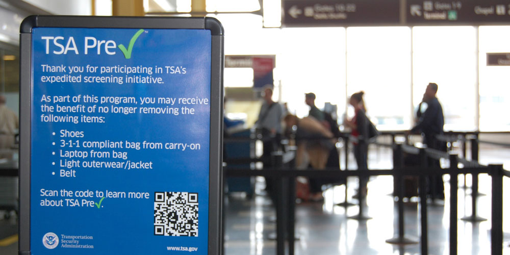 This undated image released by the Transportation Security Administration shows a sign promoting the TSA PreCheck program at at Reagan National Airport in Washington. The Transportation Security Administration's PreCheck program is open to some elite frequent fliers as well as travelers enrolled in one of the Customs & Border Protection's expedited entry programs: Global Entry, Nexus and Sentri. These travelers are considered less of a terrorist risk and therefore don't have to go through as stringent of a screening process. (AP Photo/TSA)