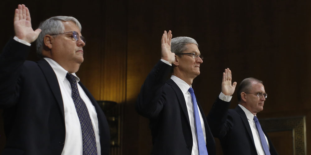 Tim Cook with other senior Apple execs at the U.S. Senate hearing in 2013
