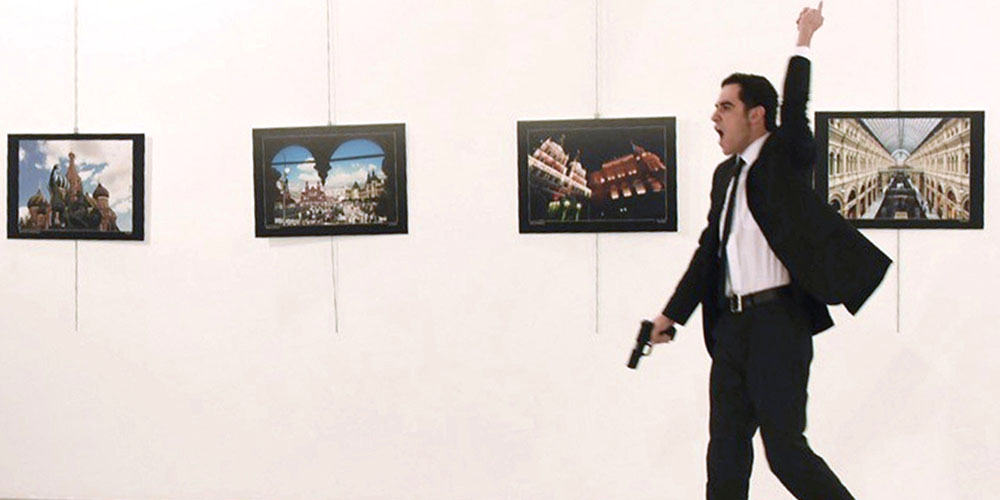 "EDITORS NOTE: Graphic content / A picture taken on December 19, 2016 shows Mevlut Mert Altintas, the gunman who killed Russia's Ambassador to Turkey, during an attack during a public event in Ankara. A gunman crying ""Aleppo"" and ""revenge"" shot Karlov while he was visiting an art exhibition in Ankara on December 19, witnesses and media reports said. The Turkish state-run Anadolu news agency said the gunman had been ""neutralised"" in a police operation, without giving further details. / AFP / Sozcu daily / Yavuz Alatan (Photo credit should read YAVUZ ALATAN/AFP/Getty Images)"
