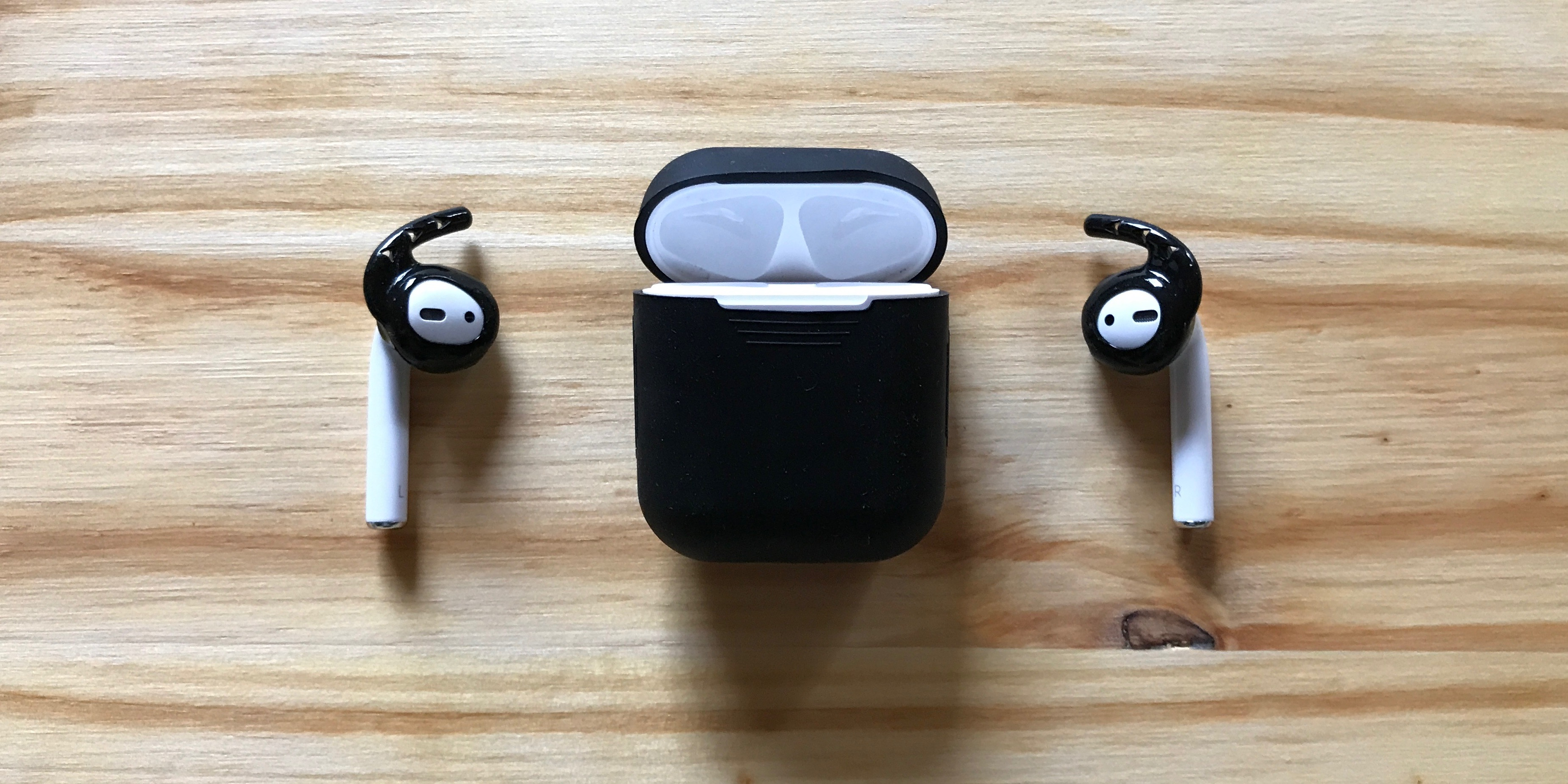 0c05aa5b625 Black Earhoox on AirPods with black Podskinz charging case cover