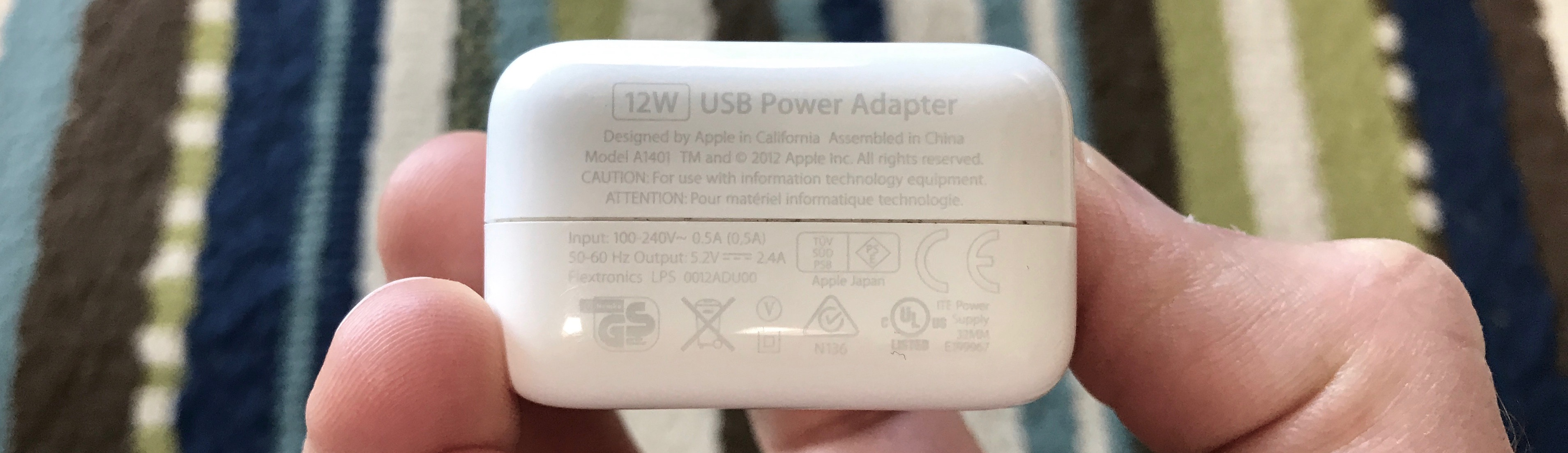 Image showing where to look on Apple power adapters for wattage details