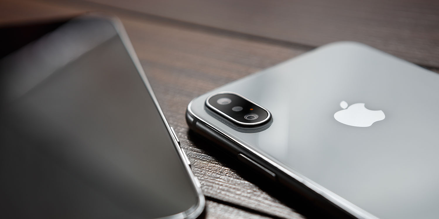 photo of AAPL slides further as iPhone lens-maker reports big fall in sales, and analysts downgrade image