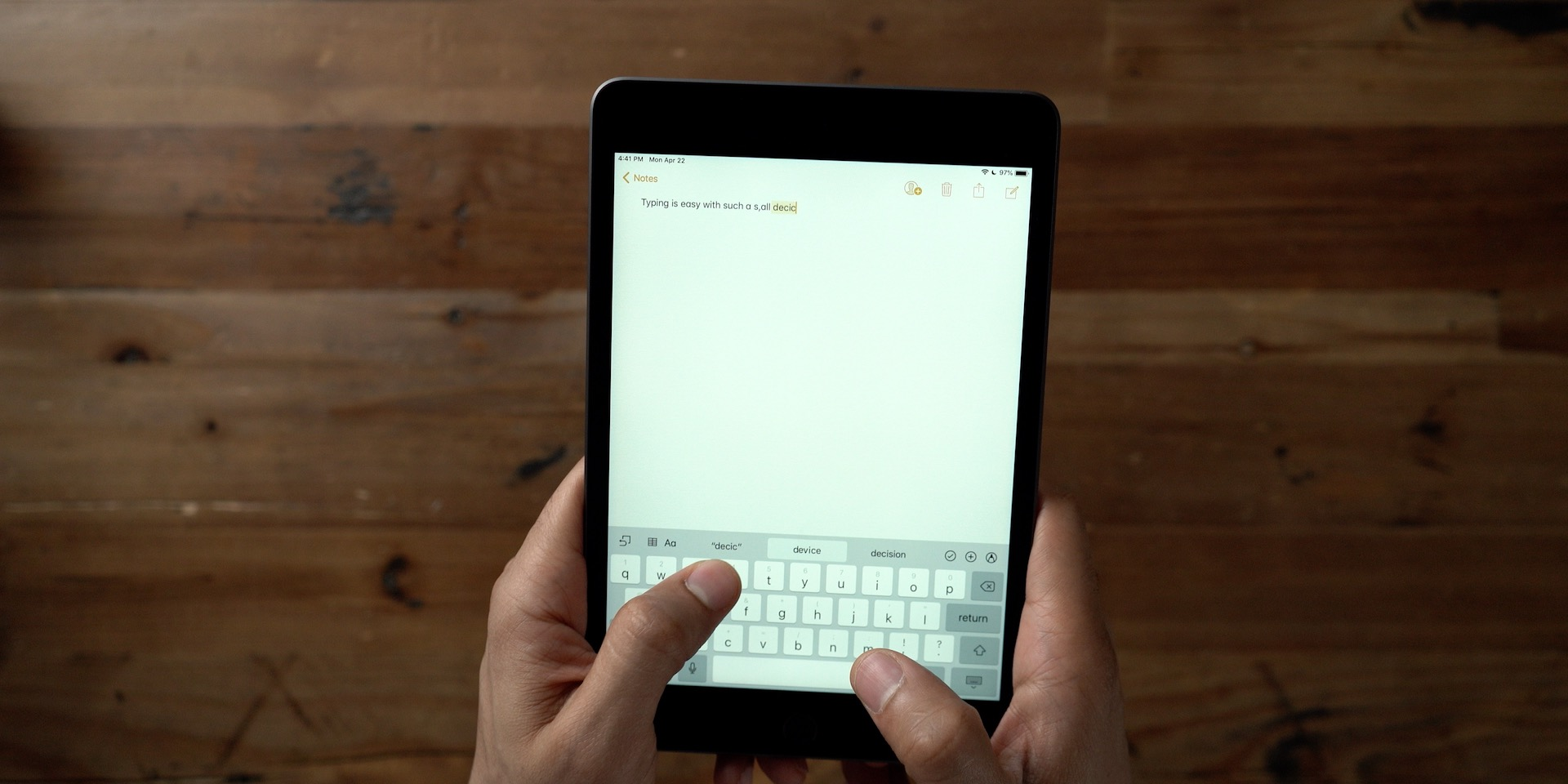 Which iPad Should You Buy? iPad mini handheld typing