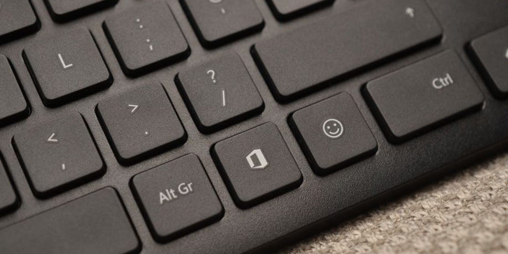 Poll: Should Apple keyboards follow Microsoft's example and have an emoji key?