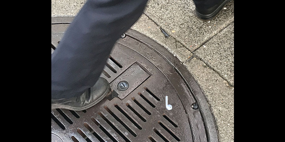 AirPods prank sees people trying to pick up stickers from the street
