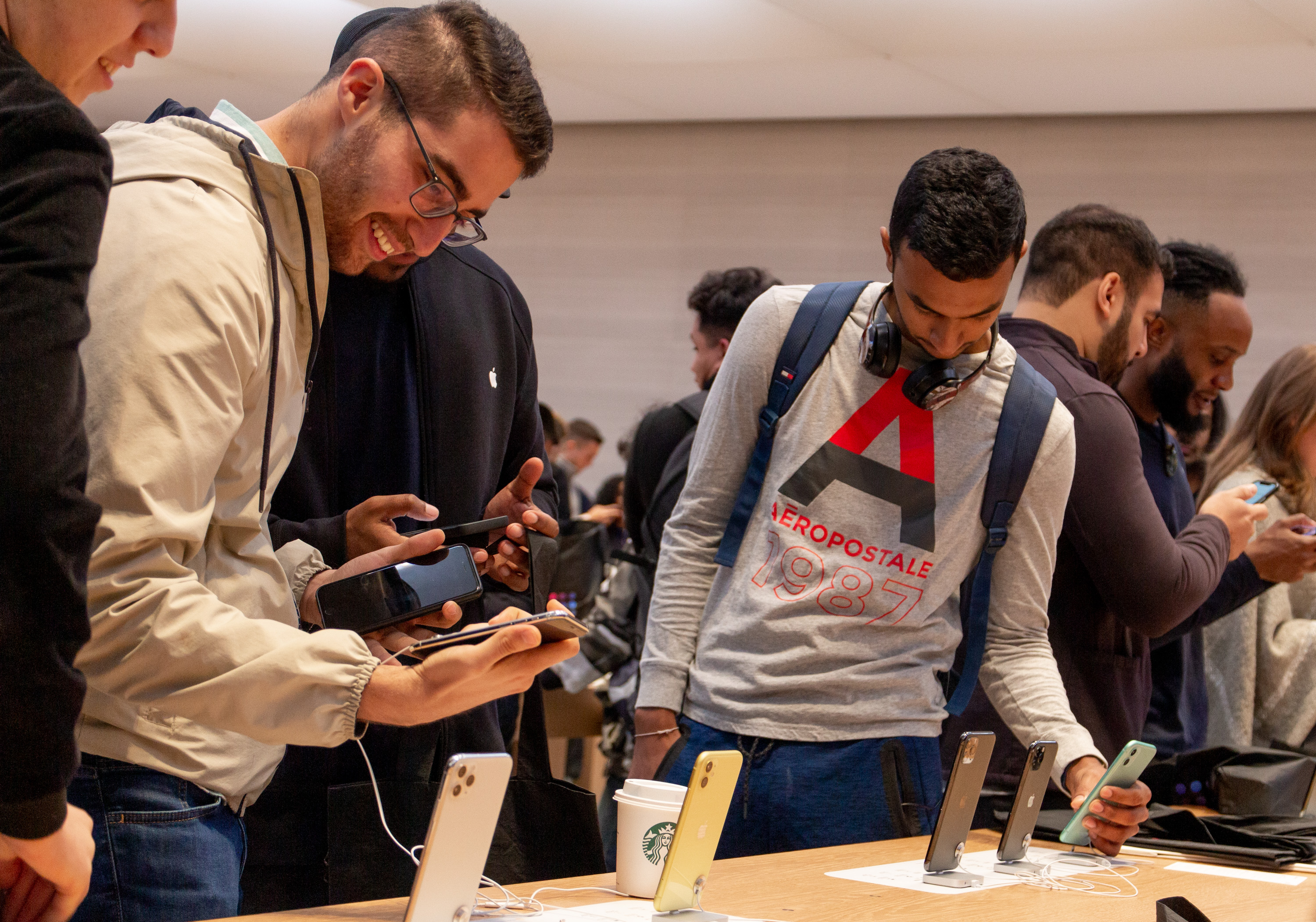 Customers explore iPhone 11 at Apple Fifth Avenue