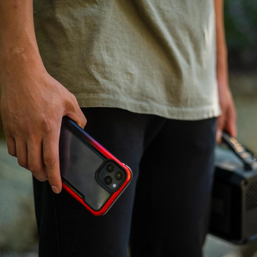 Raptic Shield iPhone 12 Red Gradient lifestyle