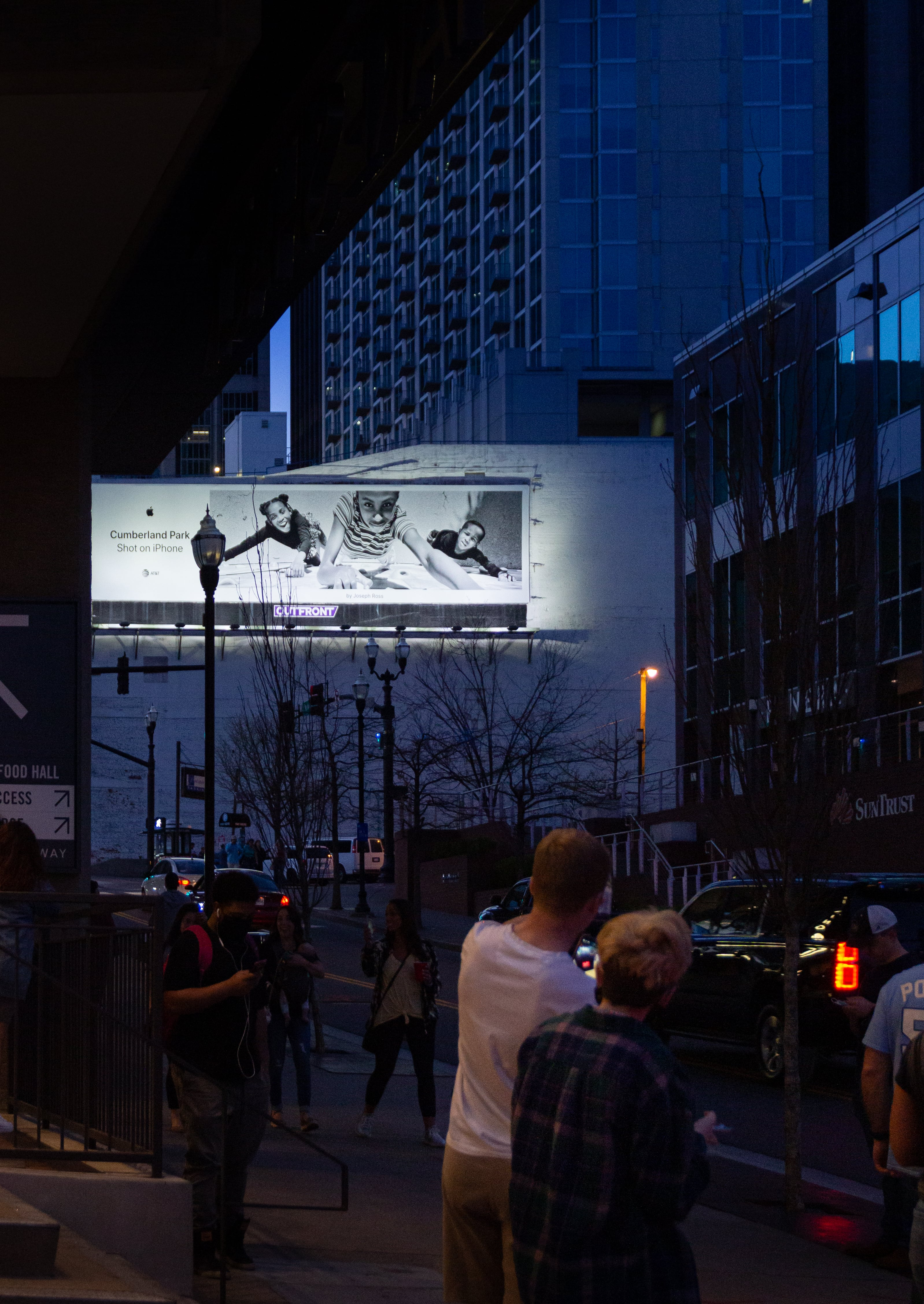 A Shot on iPhone billboard next to Apple Downtown Nashville