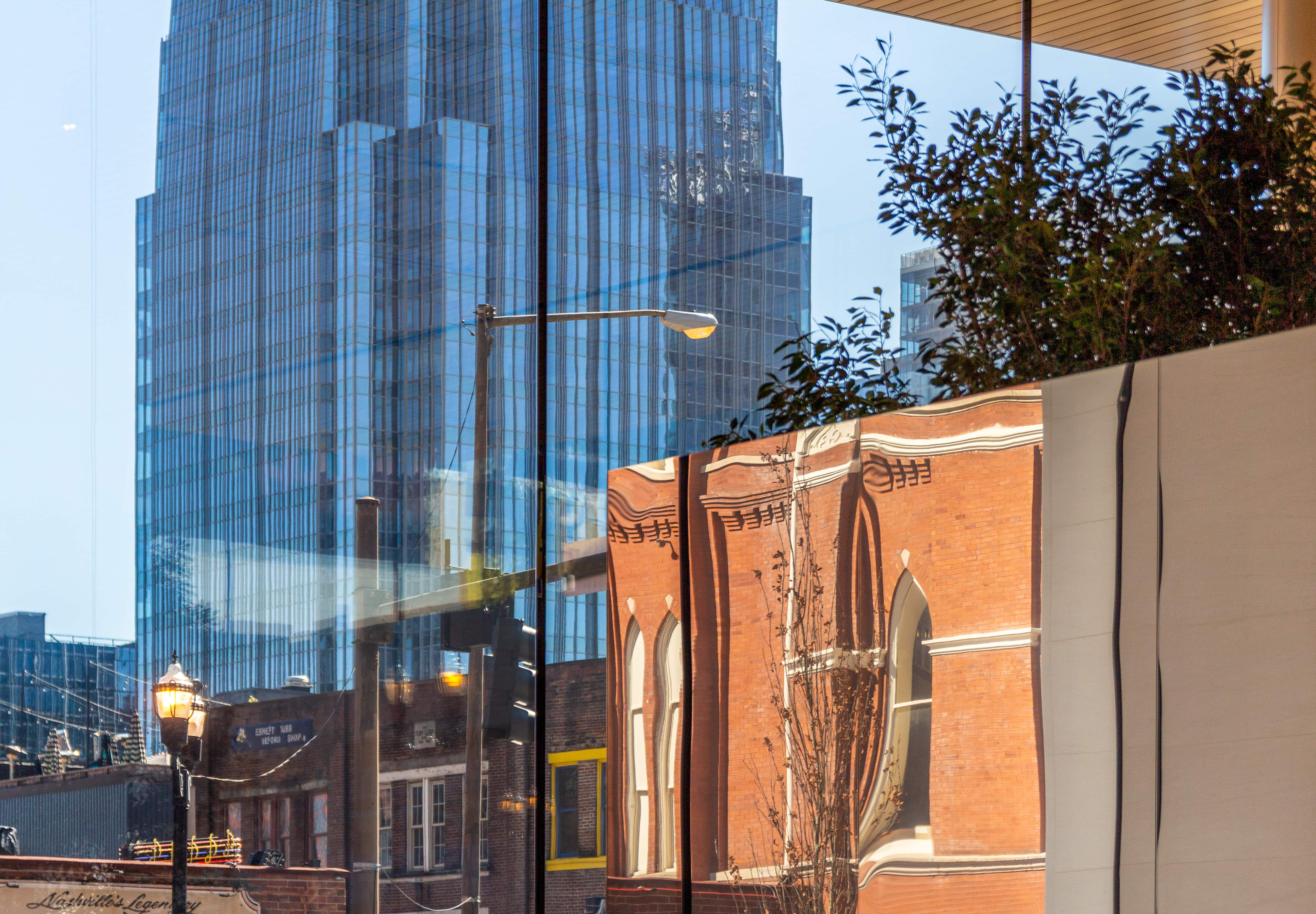 The Ryman Auditorium reflects in the mirror-polished Video Wall