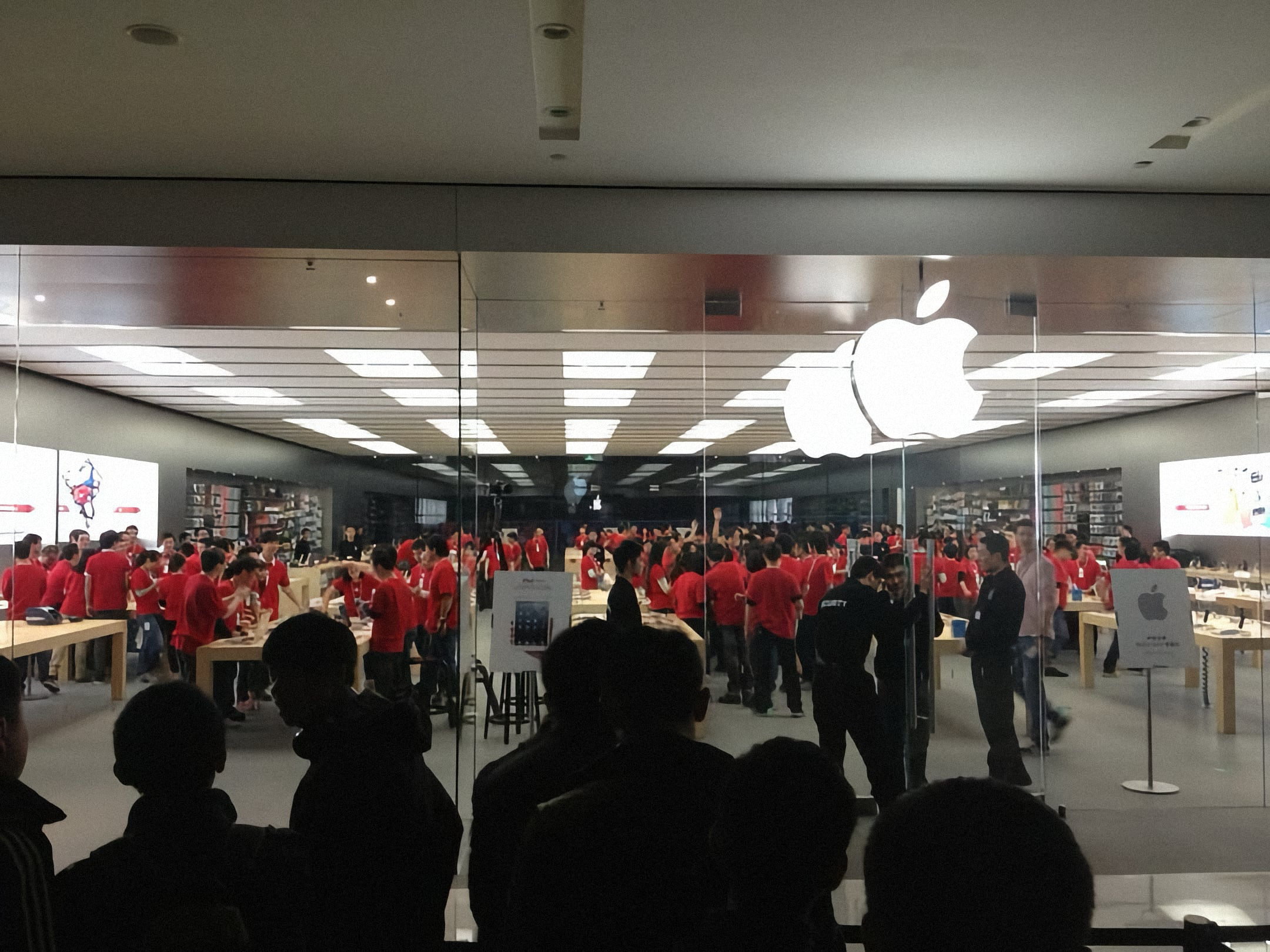 Employees cheer before the opening of Apple MixC Chengdu.