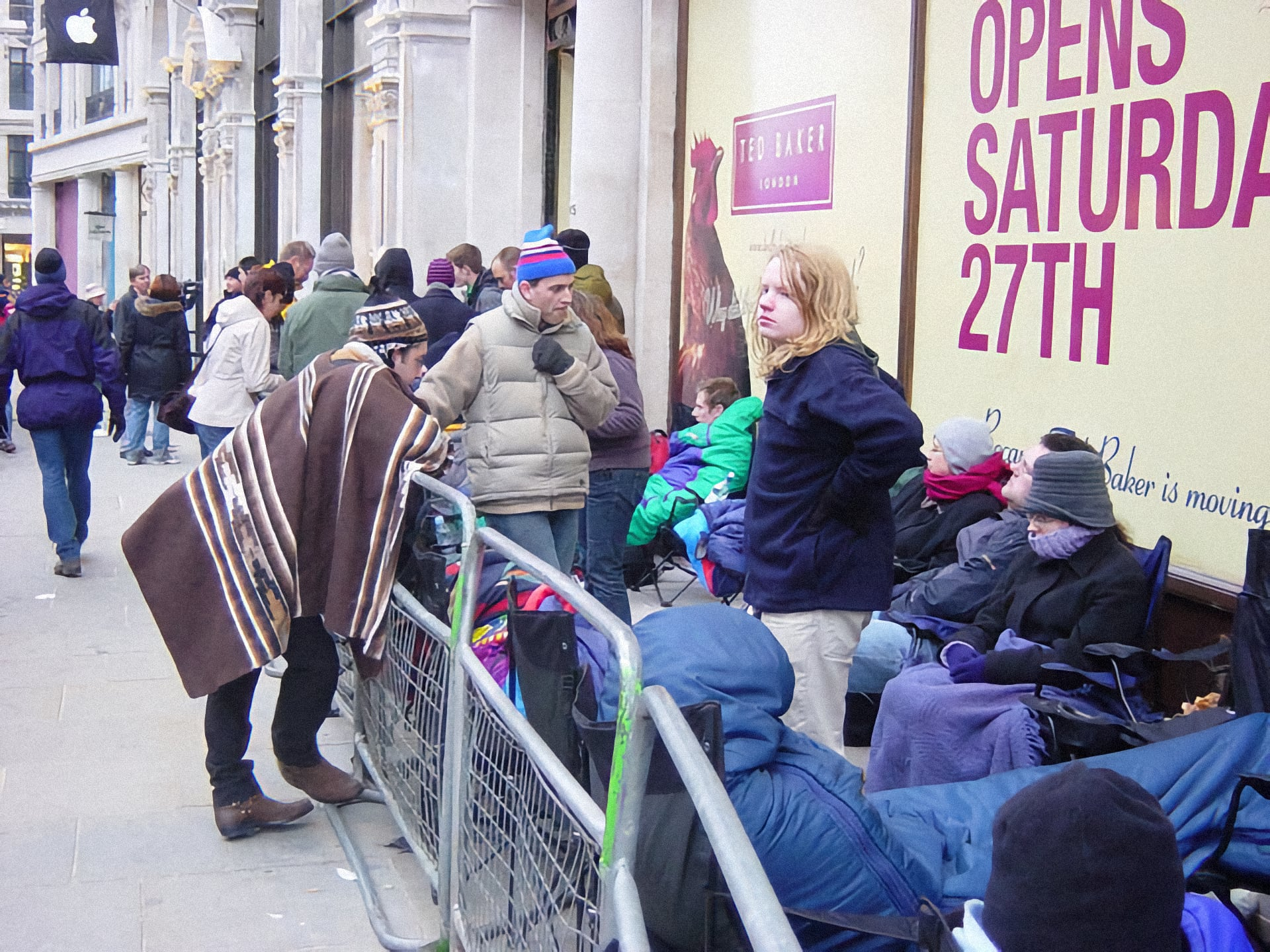 Customers bundle up outside Apple Regent Street ahead of the grand opening.