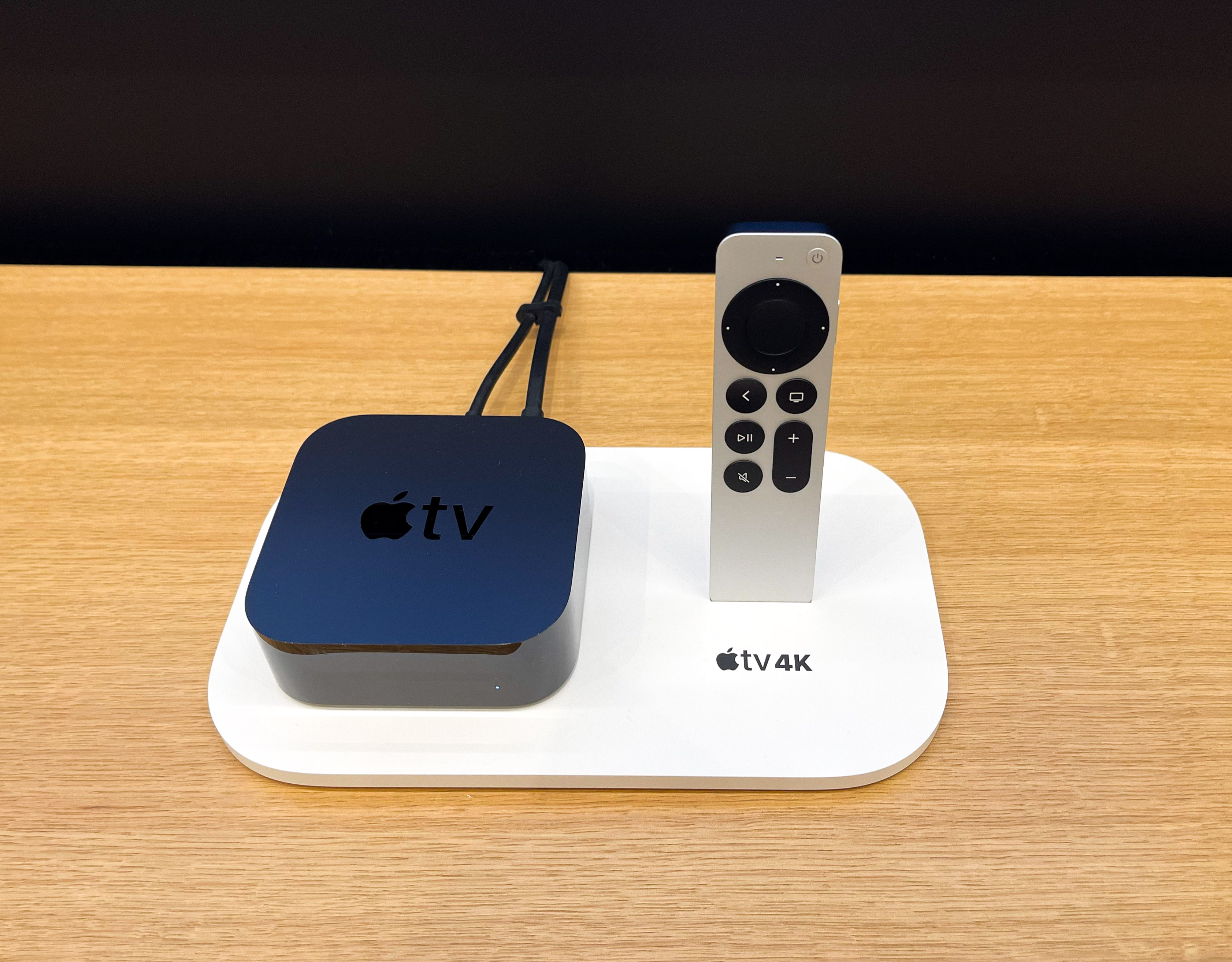 Apple TV 4K and the all-new Siri Remote displayed in a custom tray at Apple Omotesando.